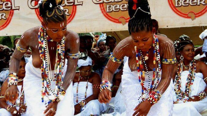 Vodoun vudu or Voodoo devotees dancing traditional Agbaza